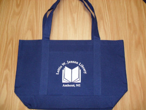 The book bag comes in royal blue canvas with the library's name printed in white.